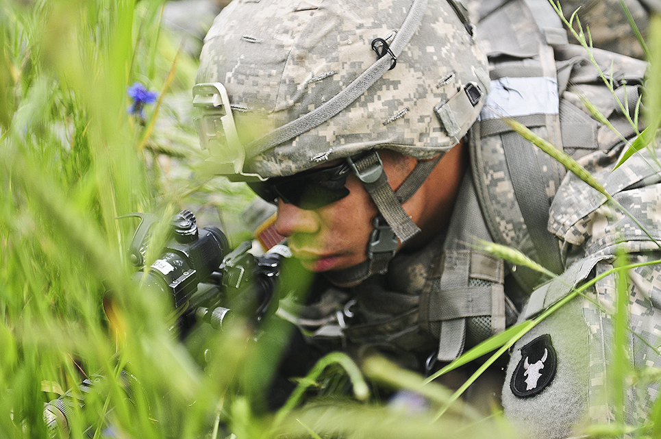 Soldiers of the 2nd Combined Arms Battalion, 136th Infantry advance on Objective Adams in the Sawalki Gap, Lithuania on June 18, 2017. As part of the multinational exercise of Saber Strike '17, the 1/34th ABCT is providing support to the Air Assault Task Force Commander, Col. Charles Kemper.