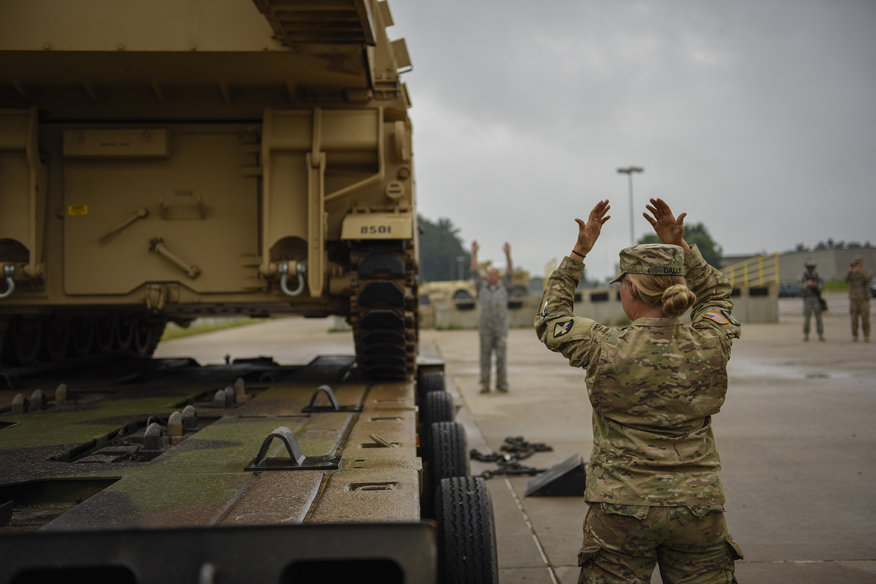 Pfc. Lydia Dally guides a Paladin Howitzer onto a trailer, helping the 1st Battalion, 125th Field Artillery, move their equipment back to home station following their annual training at Camp Ripley. Dally, with the 114th Transportation Company, was one of several team members guiding the precision load on Aug. 14, 2017. (Minnesota National Guard photo by Staff Sgt. Patrick Loch)