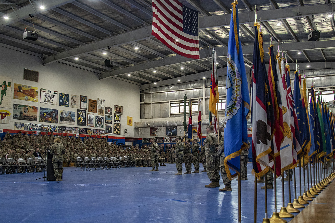 Maj. Gen. Benjamin Corell, 34th Red Bull Infantry Division commanding general and Command Sgt. Maj. Joseph Hjelmstad uncase the Division colors during a transfer of authority ceremony Nov. 12, 2018. The Minnesota National Guard unit's headquarters and headquarters battalion assumed responsibility for the Task Force Spartan mission to from the Pennsylvania National Guard's 28th Infantry Division. The 34th's HHBN is serving as a division headquarters for roughly 10,000 Soldiers conducting theater security operations in the Middle East. (U.S. Army photo by Sgt. William Boecker)