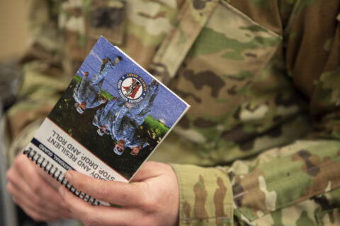 A Soldier hold the new Ready and Resilient Program booklet.