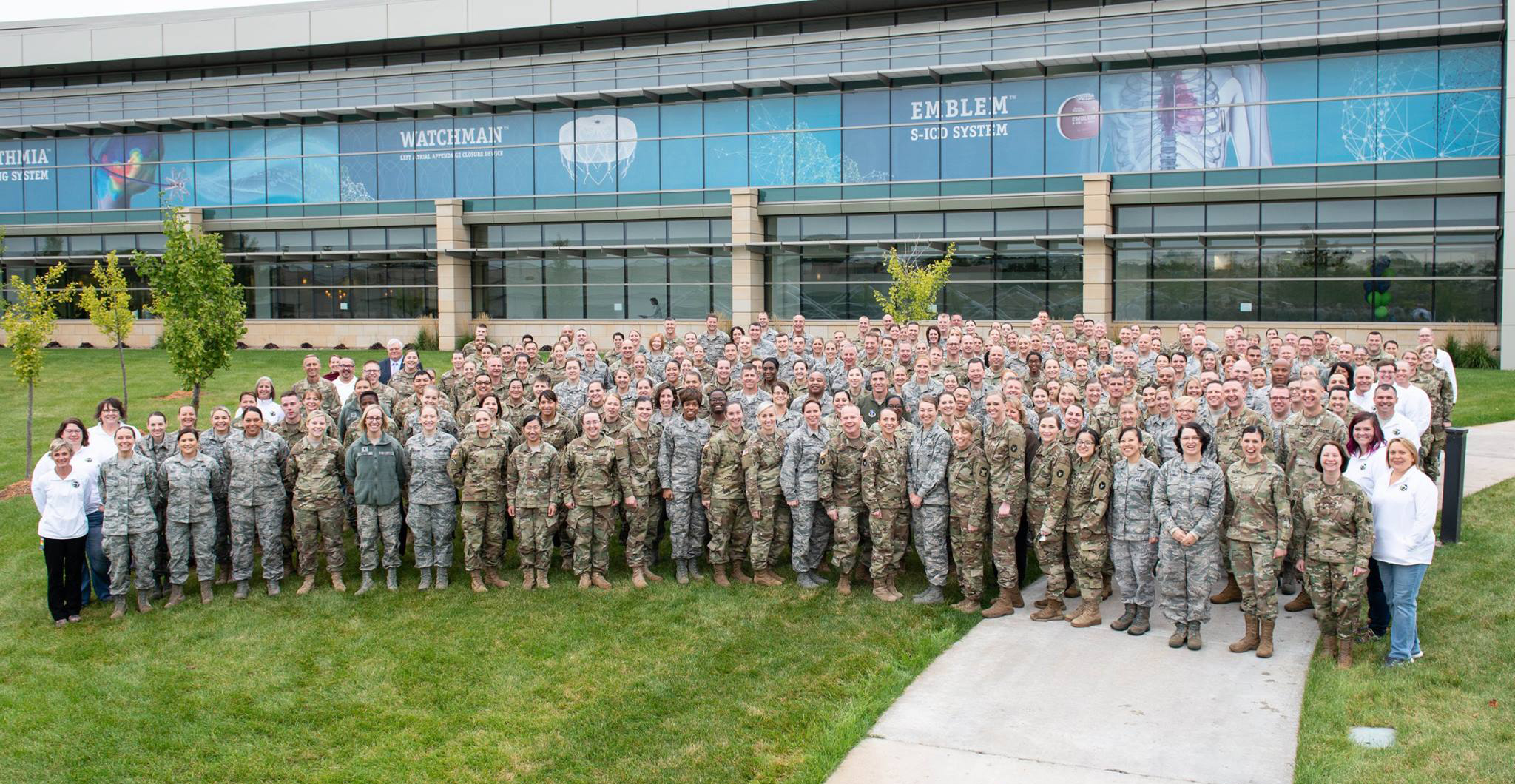 Soldiers and Airmen from the Minnesota National Guard pose for a photo during the 2018 Women's Leadership Forum at Boston Scientific, Sept. 29, 2018.