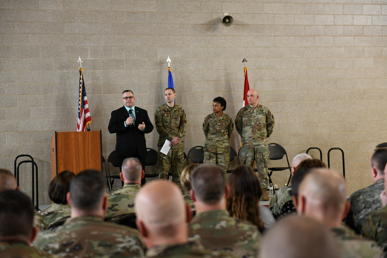 From right to left, the Minnesota National Guard's Sexual Assault Response Coordinator, Minnesota National Guard's State Judge Advocate, representative from the National Guard Bureau Office of Complex Investigation, and a representative from the National Guard Bureau Special Victims' Counsel, address approximately 500 Soldiers, Airmen and civilian employees during a two-hour sexual assault stand-down on April 25, 2019, at an armory in Arden Hills, Minnesota, as a part of Sexual Assault Awareness Month. This event is the first in an anticipated series of events across the state. (Minnesota National Guard photo by Sgt. Sebastian Nemec)