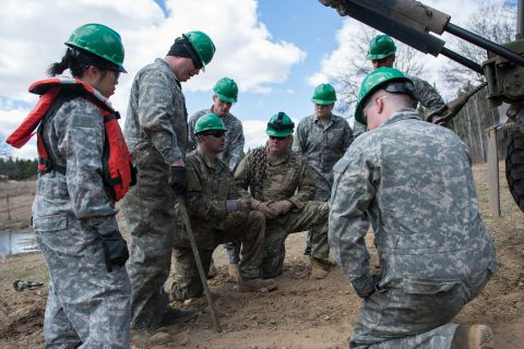 A group of Soldiers from the 175th Regiment Regional Training Institute's Wheeled Vehicle Recovery course prepare to pull a truck out of water at Camp Ripley, Minnesota, on April 26, 2019. Soldiers travel from several states to complete this course to obtain the Additional Skill Identifier H8. (Minnesota National Guard photo by Sgt. Sebastian Nemec)