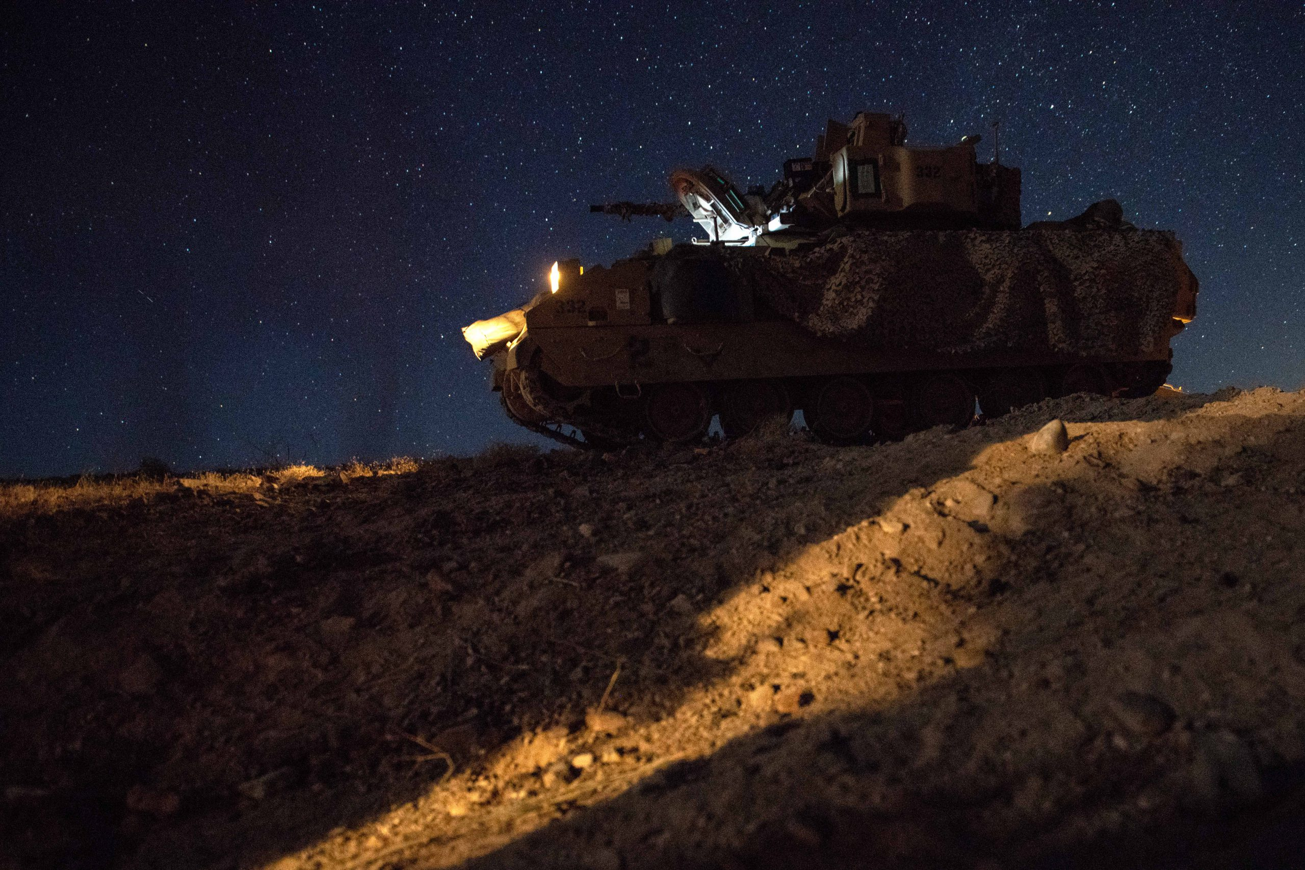 """Soldiers of the 1st Combined Arms Battalion, 194th Armor Regiment, wait to start an overnight mission to gain control of the occupied city of Razish during a decisive-action training exercise in the desert environment of the National Training Center, Fort Irwin, California, on July 24, 2020. Soldiers loaded into Bradley Fighting Vehicles early in the morning to reach their objective before sunrise in an effort to surprise the opposing force known as Blackhorse. Blackhorse Soldiers of the 11th Armored Cavalry Regiment-Blackhorse, are dedicated to testing units in """"The Box.""""<br /><br /><br /><br />Brigade Soldiers are taking part in one of the U.S. Army's most challenging land force training exercises and have prepared for entering """"The Box"""" for over a year, including during their 2019 annual training at Fort Hood, Texas, where they completed an eXportable Combat Training Center exercise.<br /><br /><br /><br />The 1st Combined Arms Battalion, 194th Armor Regiment, is a Minnesota Army National Guard battalion headquartered in Brainerd. The overall unit mission is to provide heavy armor and mechanized infantry ground combat power to the 1st Armored Brigade Combat Team, 34th Infantry Division. (U.S. Army photo by Sgt. Sebastian Nemec)"""