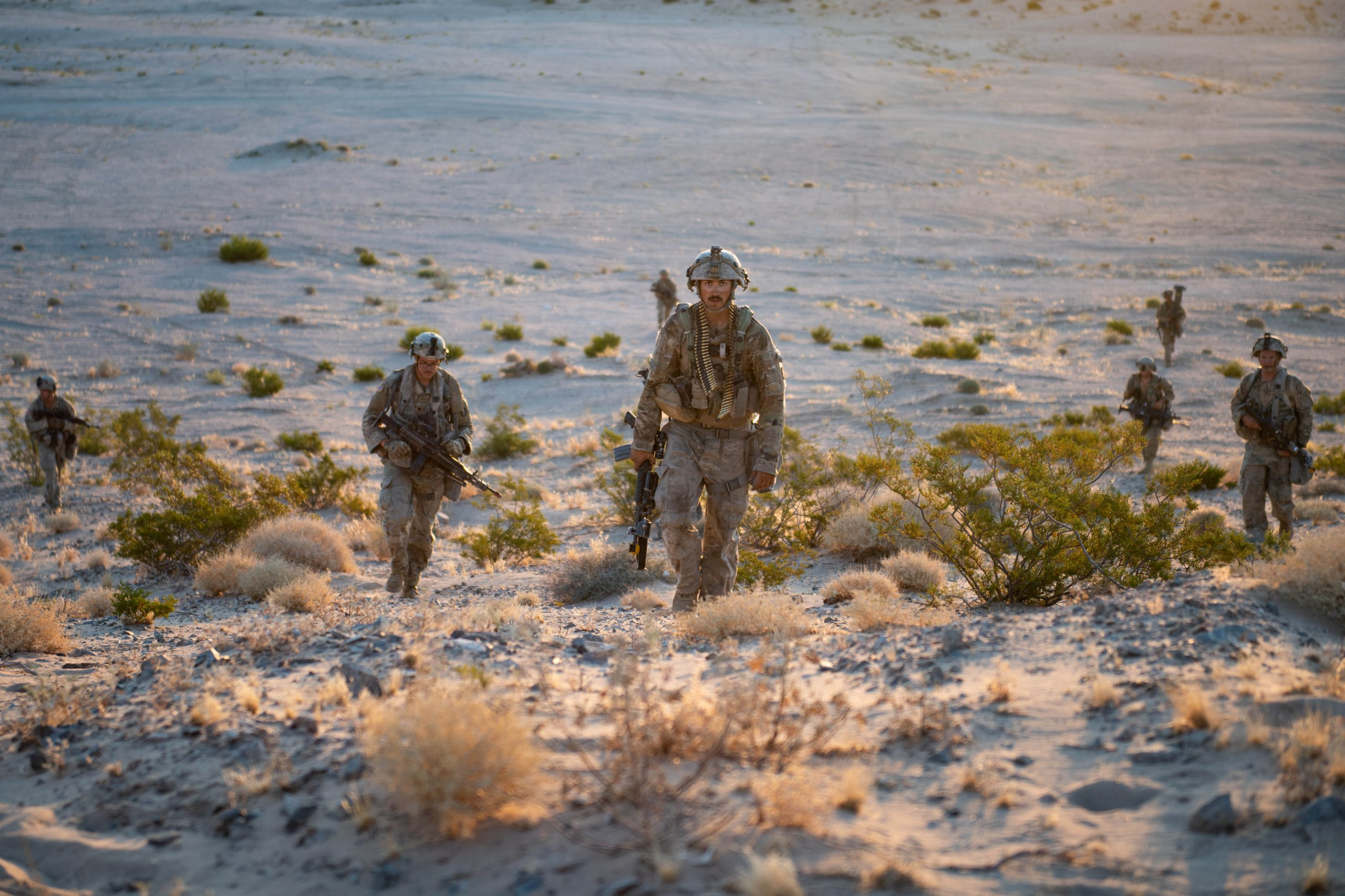 """Soldiers of the 1st Combined Arms Battalion, 194th Armor Regiment, climb a hill in the early morning hours of July 25, 2020, on a mission to gain control of the occupied city of Razish during a decisive-action training exercise in the desert environment of the National Training Center, Fort Irwin, California. The Soldiers started their mission under the cover of night in an effort to surprise the opposing force known as Blackhorse. Blackhorse Soldiers of the 11th Armored Cavalry Regiment-Blackhorse, are dedicated to testing units in """"The Box.""""    Brigade Soldiers are taking part in one of the U.S. Army's most challenging land force training exercises and have prepared for entering """"The Box"""" for over a year, including during their 2019 annual training at Fort Hood, Texas, where they completed an eXportable Combat Training Center exercise.    The 1st Combined Arms Battalion, 194th Armor Regiment, is a Minnesota Army National Guard battalion headquartered in Brainerd. The overall unit mission is to provide heavy armor and mechanized infantry ground combat power to the 1st Armored Brigade Combat Team, 34th Infantry Division. (U.S. Army photo by Sgt. Sebastian Nemec)"""